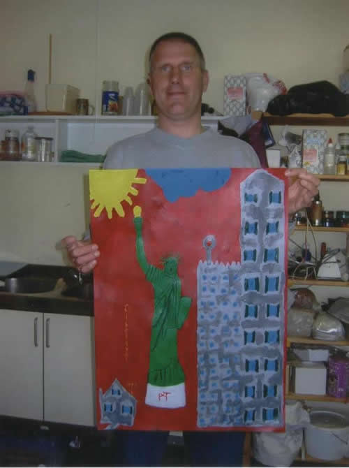 Picture of the painting: 'Liberty? - Jack Terrible with his painting of the Statue of Liberty!'